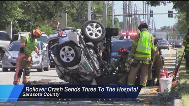 Rollover crash into oncoming traffic sends three to the hospital